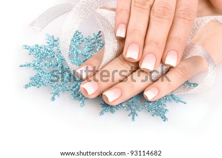 hands with beautiful winter design, snowflakes and ribbon solated on white