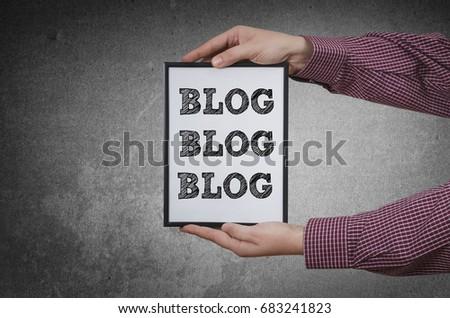 Hands with Blog Blog Blog framed on dark background #683241823