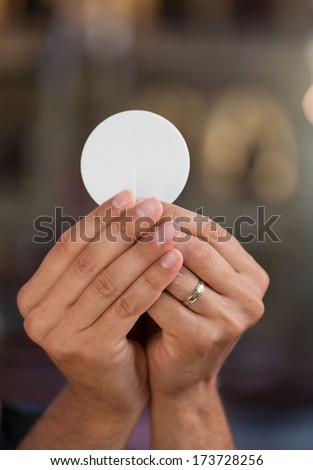 Hands with bread for holy communion.