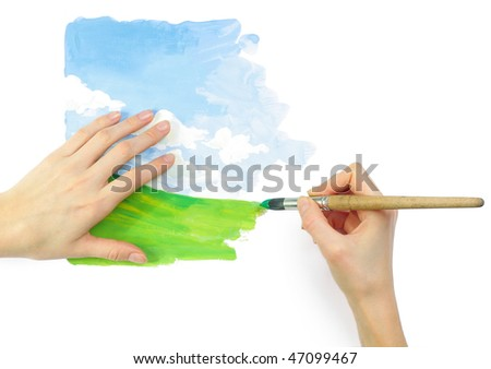 Hands with brush and bright nature image