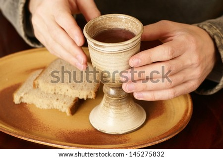 Hands with chalice and bread