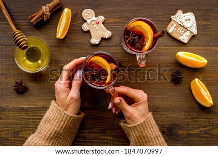 Hands with Christmas hot drink - mulled red wine, top view Foto stock ©