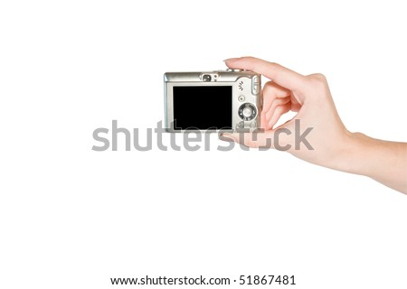 HANDS WITH DIGITAL CAMERA