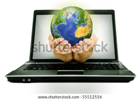 Hands with earth coming from laptop screen - stock photo