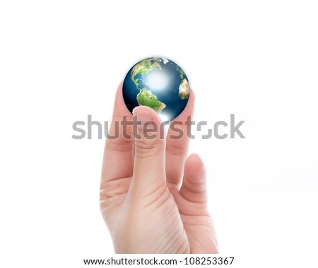 Hands with earth (Elements of this image furnished by NASA)