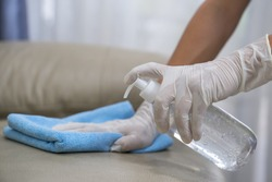 Hands with gloves to clean the sofa ,virus protection