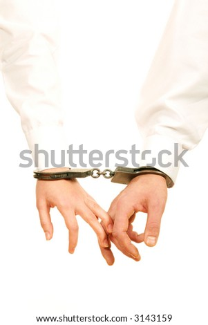 Hands with handcuffs - stock photo