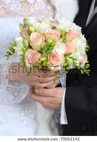 Hands with holding flower bouquet