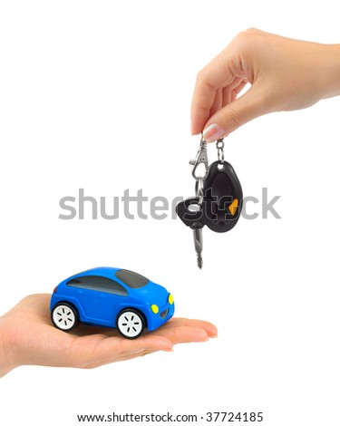 Hands with keys and car on white background