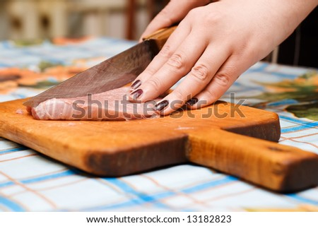 hands with knife cutting raw meat stock photo 13182823 shutterstock. Black Bedroom Furniture Sets. Home Design Ideas