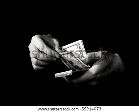 Hands with packs of dollars over black