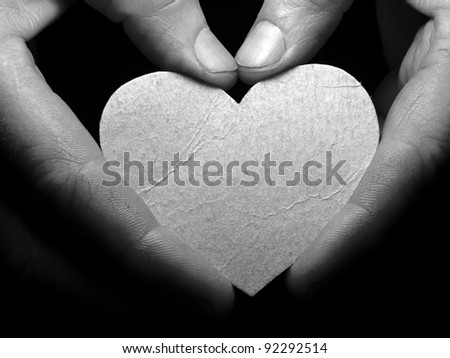 Hands with paper heart. Protect concept.
