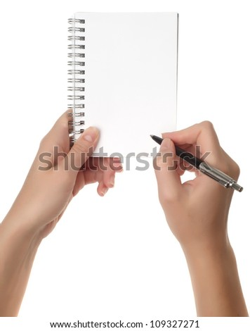 Hands with pen over note paper isolated on white background