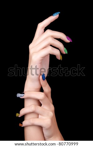 Hands with perfect sparkling colourful manicure