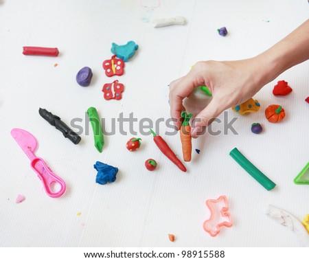 hands with plasticine