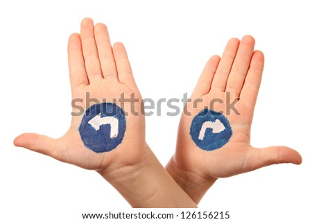 Hands with the drawn traffic signs as a designator of directing
