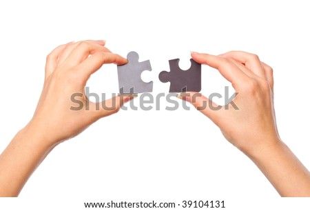 Hands with two puzzles. Isolated on white background