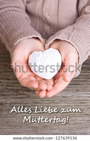 Hands with white heart and lettering mother`s day/ mother`s day/heart