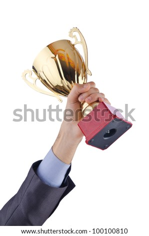 Hands with winners cup on white