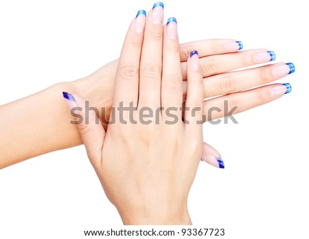 Hands with woman's professional blue french nails manicure isolated on white