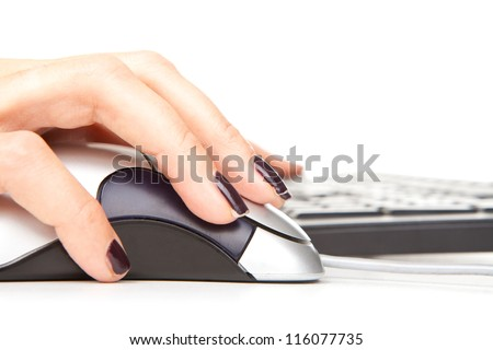 Hands working on the keyboard with mouse on white
