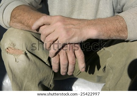 Hands, wrinkles, an old age, a dirt