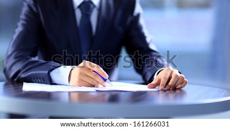 Hands writing on a paper - Shutterstock ID 161266031