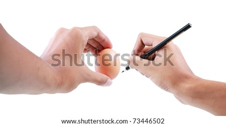 hands writing on egg. isolated over white background