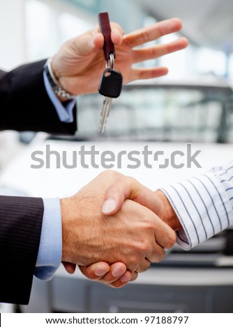 Handshake after buying a car and handling keys