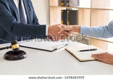 Handshake after cooperation between attorneys lawyer and clients discussing a contract agreement hope of victory over legal fighters  Concepts of law  advice