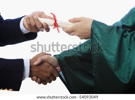 handshake and a diploma at graduation