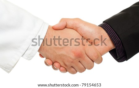 Handshake between a businessman and a doctor, isolated on white.