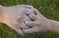 Handshake between a two children. Friends shaking hands.  The concept of mutual friendship and the union of two people. Friendship and ties