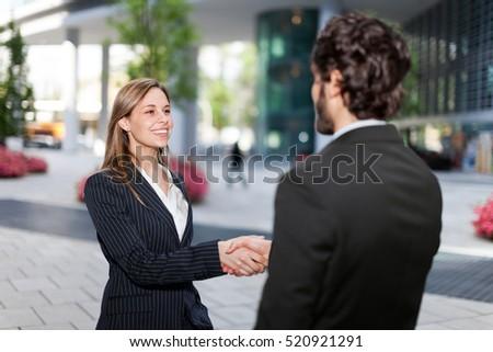 Shutterstock Handshake between business colleagues outdoor