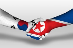Handshake between north korea and south korea flags painted on hands, illustration with clipping path.