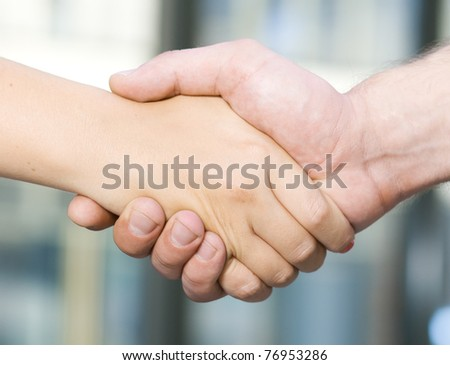 Handshake between office workers - man and woman - stock photo