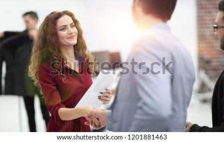 handshake between the designer and the client
