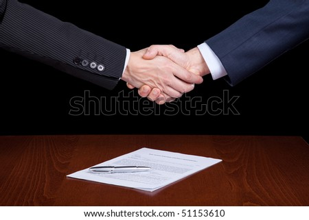 handshake between two businessman after closing the contract
