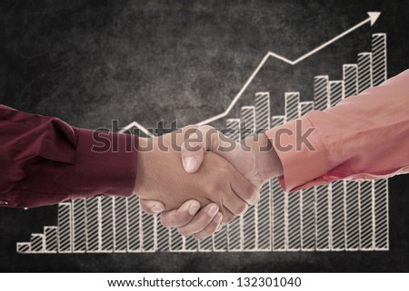 Handshake between two businessmen upon successful transactions
