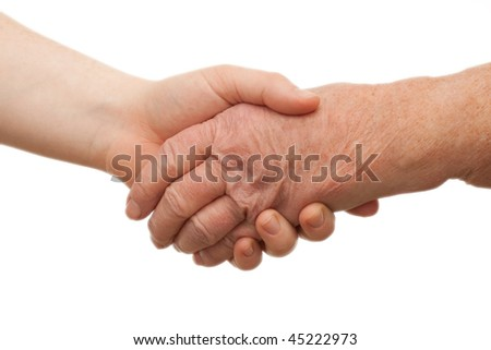 Handshake - between young and old  females on white background - stock photo