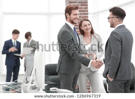 handshake business partners at a meeting #1286967319