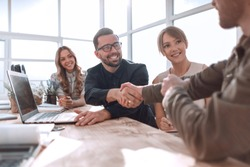 handshake business people at a meeting in the office