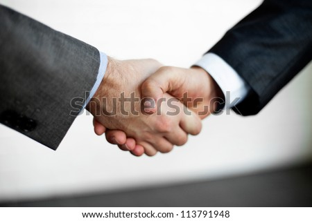 Handshake closeup of two businessman.