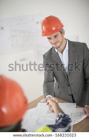 handshake during a meeting about a build project