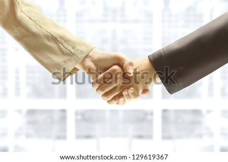Handshake in the office, the conclusion of the contract.