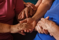 handshake interlocked hands older women from the same family