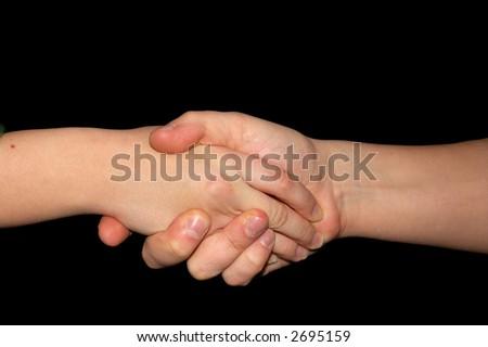 Handshake isolated on black