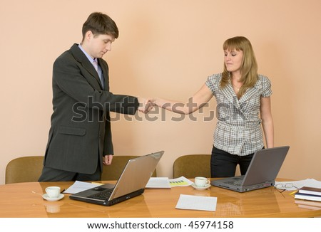 Handshake men and young women in the office