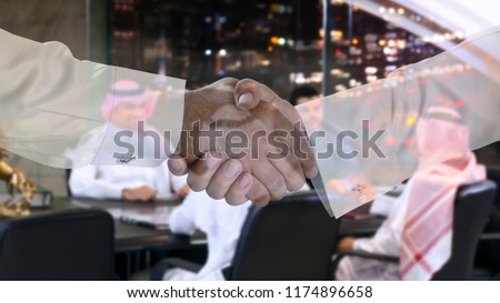 Handshake multi exposure with Saudi Arab businessmen meeting in the background