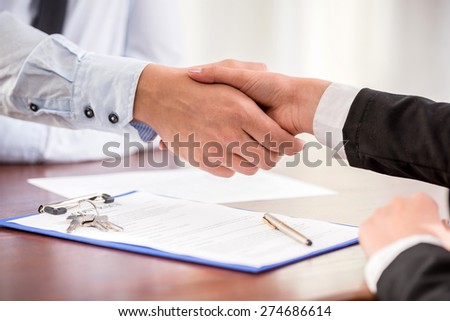 Handshake of a real estate agent and a client.